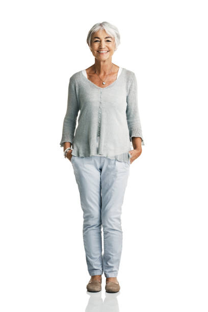 Getting older doesn't mean life's over Studio portrait of a senior woman posing with her hands in her pockets against a white background hands in pockets stock pictures, royalty-free photos & images