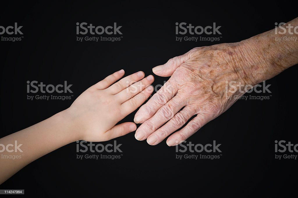 Getting older – young and old hands stock photo