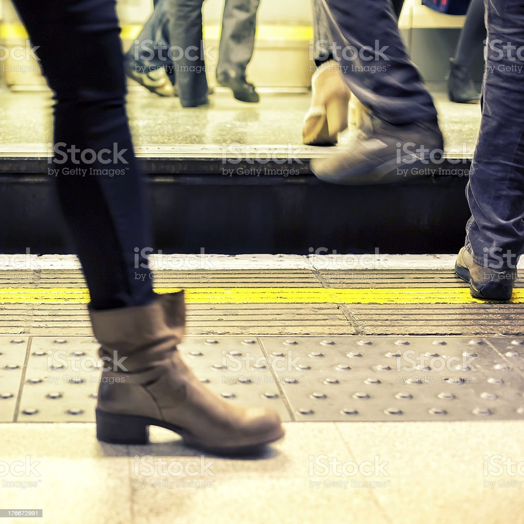 Getting on the tube royalty-free stock photo