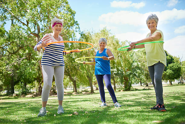 getting our groove back? we never lost it! - hula hoop workout stock-fotos und bilder
