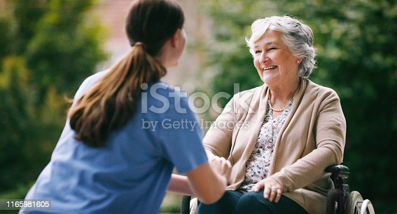 Shot of a senior woman in a wheelchair being cared for a nurse