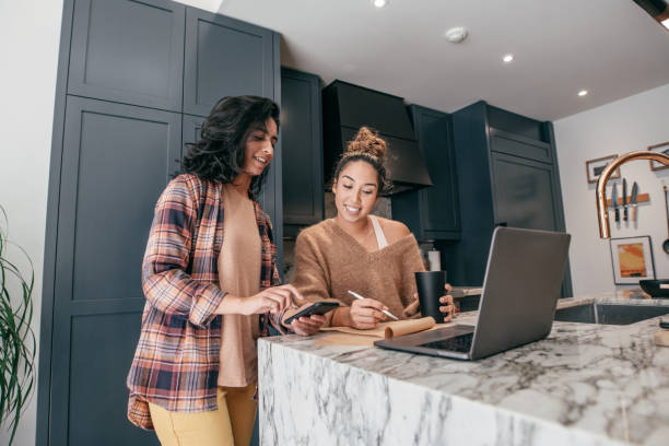 Getting professional consultation at home Two young students sitting on the kitchen, They are vlooging and preparing the meal interior designer stock pictures, royalty-free photos & images