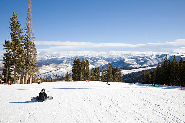Getting Ready for a Run Boarders buckle up for the next run.For more Vail and Beaver Creek: beaver creek colorado stock pictures, royalty-free photos & images