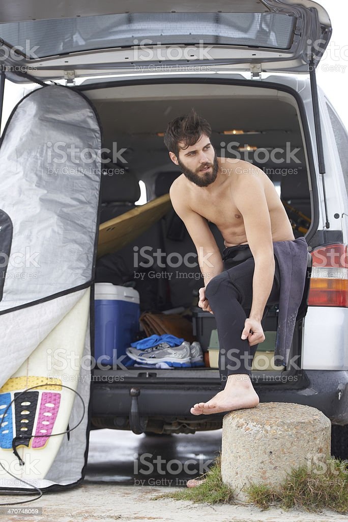 Getting ready for an early surf session stock photo