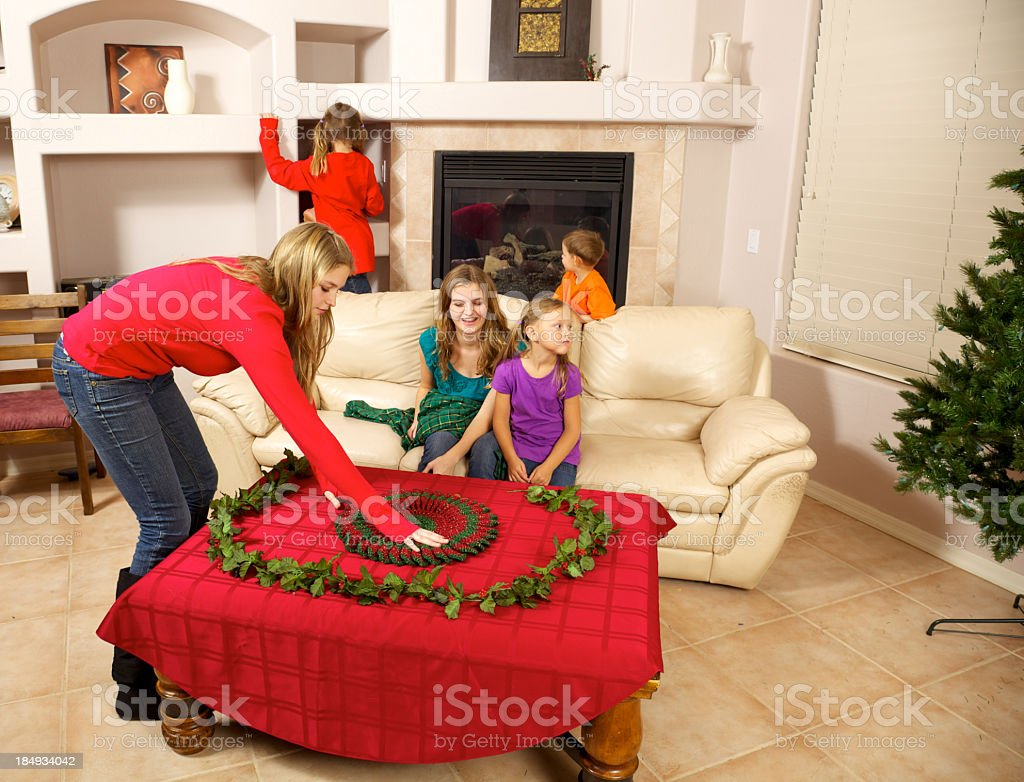 Getting Ready for Christmas with Children and Teens together stock photo