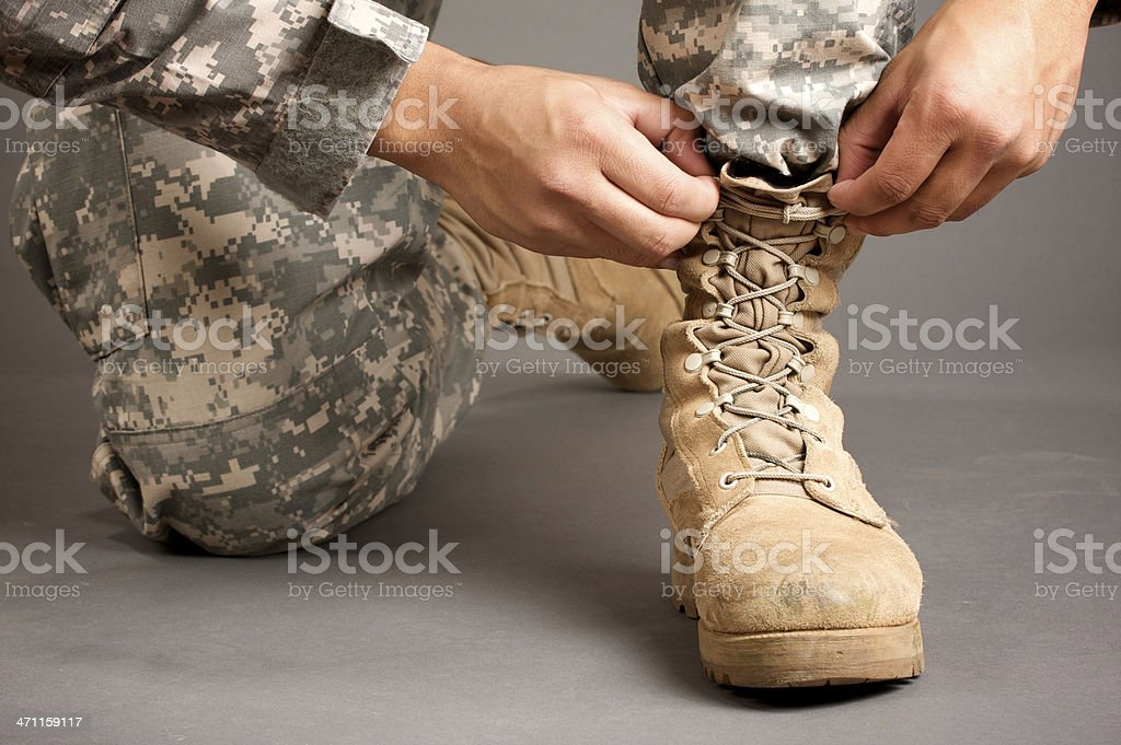 getting ready for the military, boots stock photo