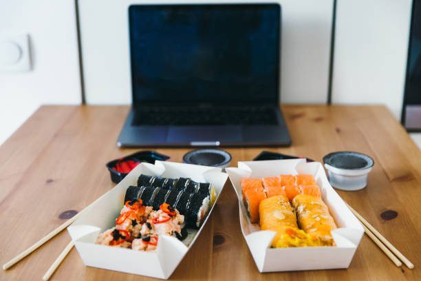 Getting ready for watching movies with sushi rolls staying at home stock photo