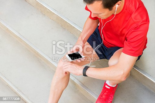 Getting ready for your daily workout and checking your application on your mobile phone to start your run