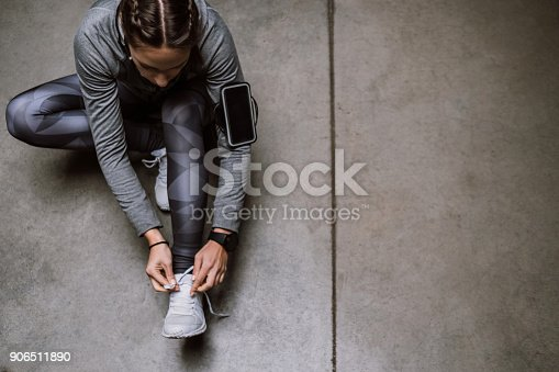 Young athlete jogging in underground garage
