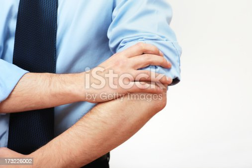 businessman roll up his shirtsleeve and getting ready for work