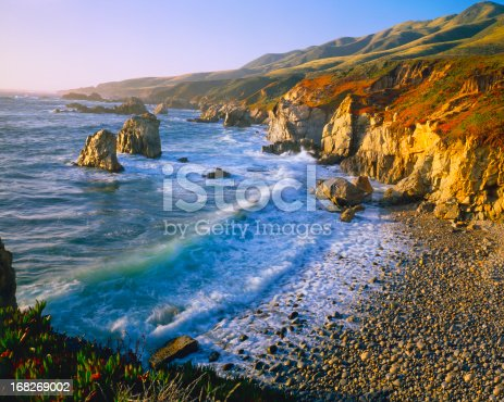 The refreshing Big Sur Coast Of California With Waves Crashing Against Rocky Shores all glowing at Garrapata State Beach Park
