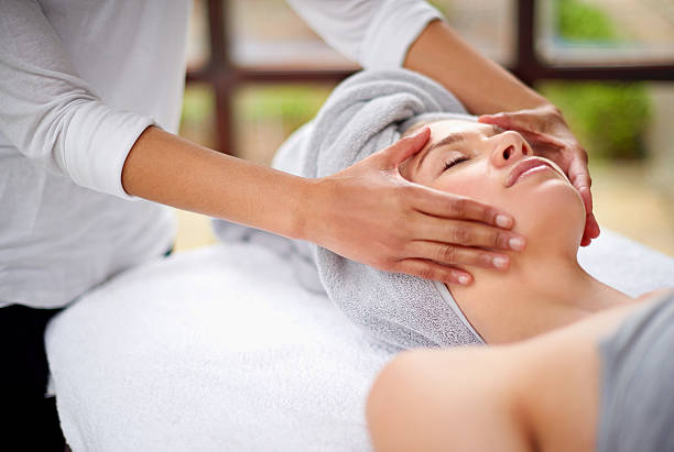 getting rid of all the tension - spa treatment stock photos and pictures