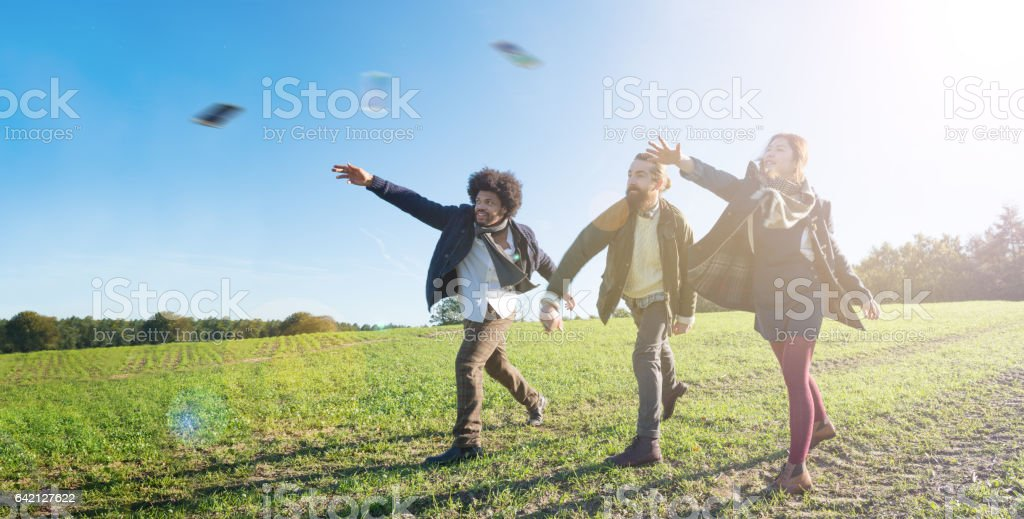 Getting rid of their phones by throwing them away stock photo