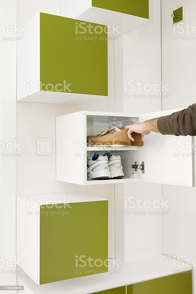 getting shoes from shoe cabinet stock photo