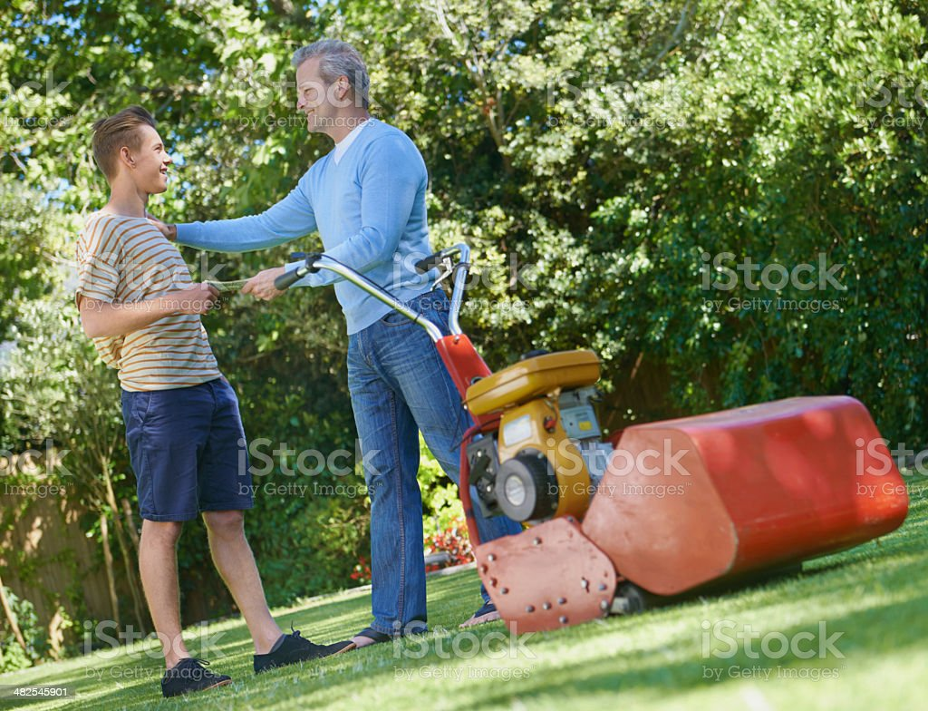 Getting some cash for mowing the lawn stock photo