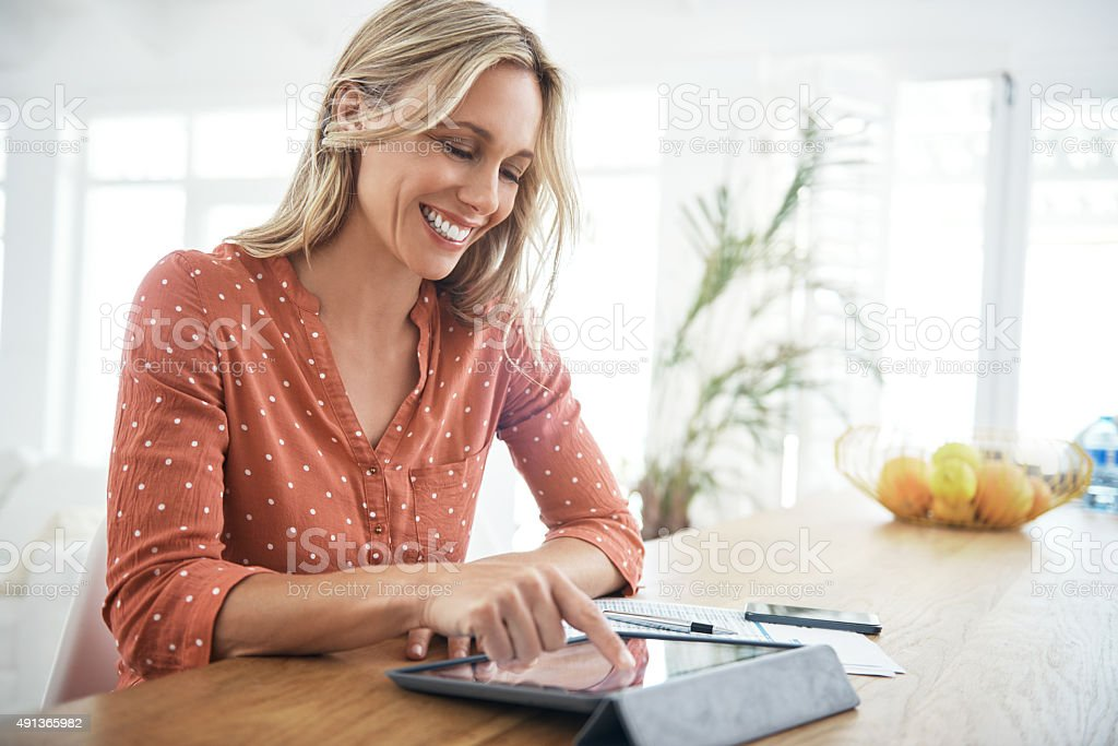 Getting some work done at home stock photo