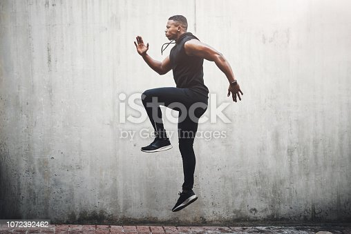 Full length shot of a handsome young man skipping on the spot while exercising outside