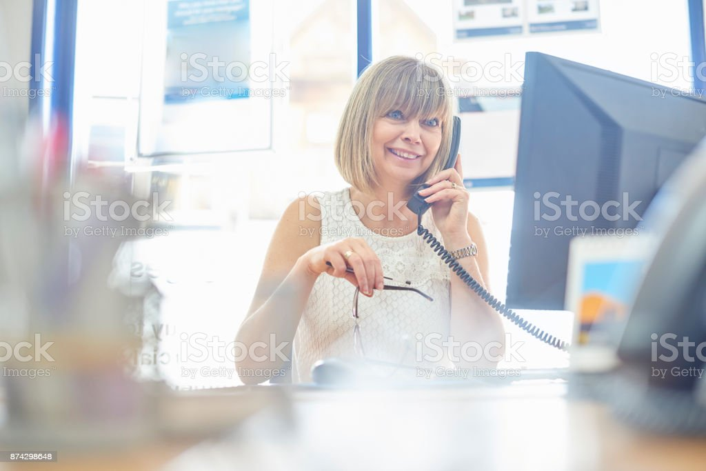 Getting the deal done on the phone stock photo