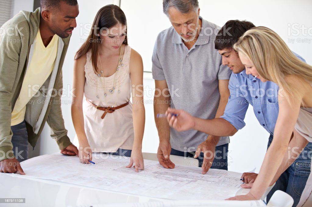 Getting the dimensions right on their blueprints royalty-free stock photo