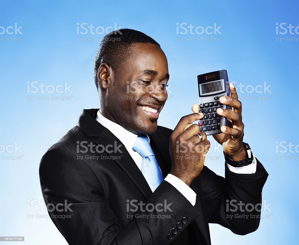 Getting the numbers right is easy! Smiling man with calculator royalty-free stock photo