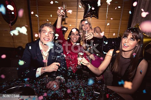 Shot of a group of friends having an awesome time partying in the club.