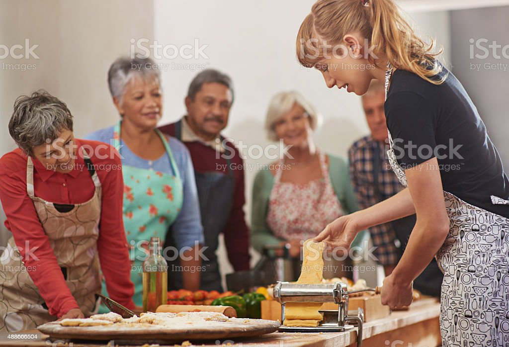 Getting the pasta dish rolling stock photo