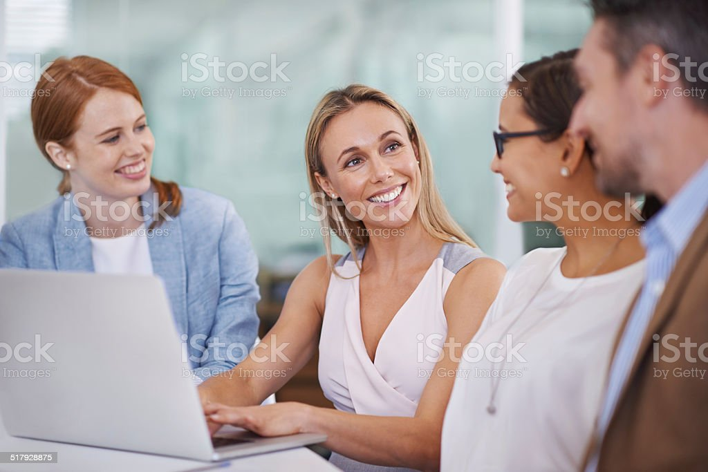 Getting the work done together stock photo
