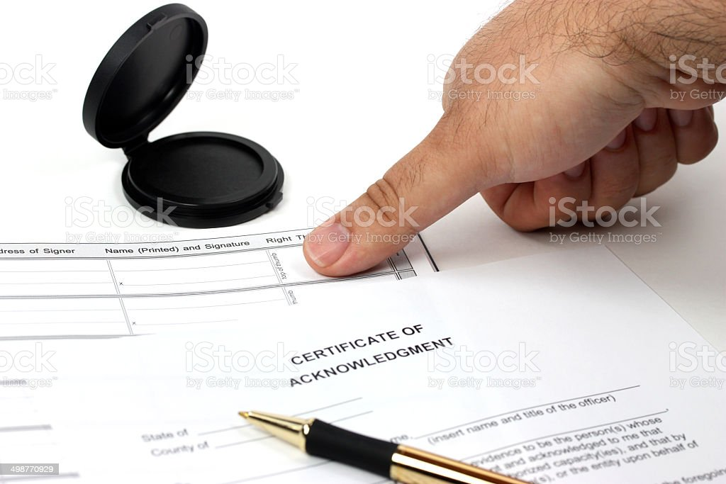 Getting thumb print for official record stock photo