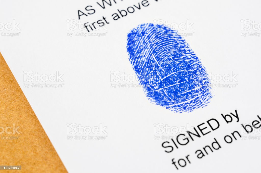 Getting thumb print for signature stock photo