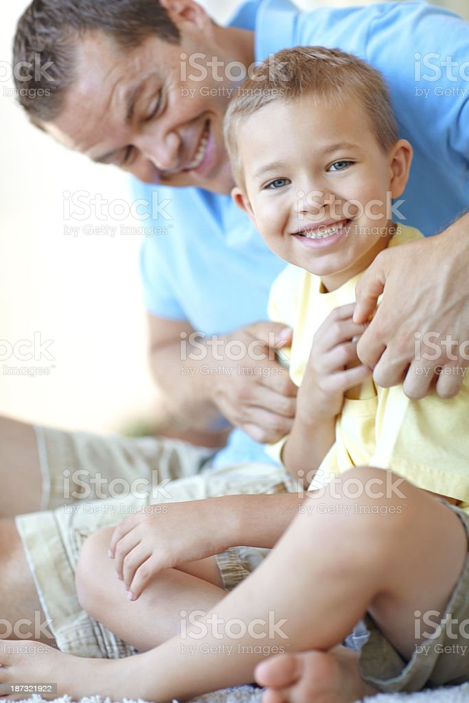 Getting tickled by dad royalty-free stock photo