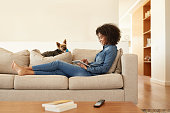 Shot of a young woman relaxing on the sofa with her digital tablet at homehttp://195.154.178.81/DATA/i_collage/pu/shoots/805808.jpg