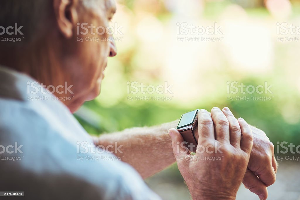Getting to know technological gadgets in the golden years stock photo