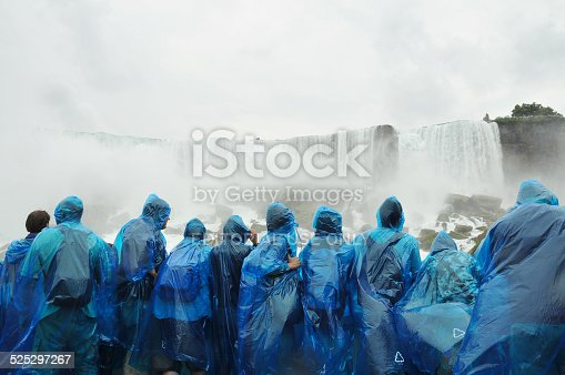 Niagara Falls, Ontario, Canada - August 9, 2012: Tourists aboard Maid of The Mist get close to the falls