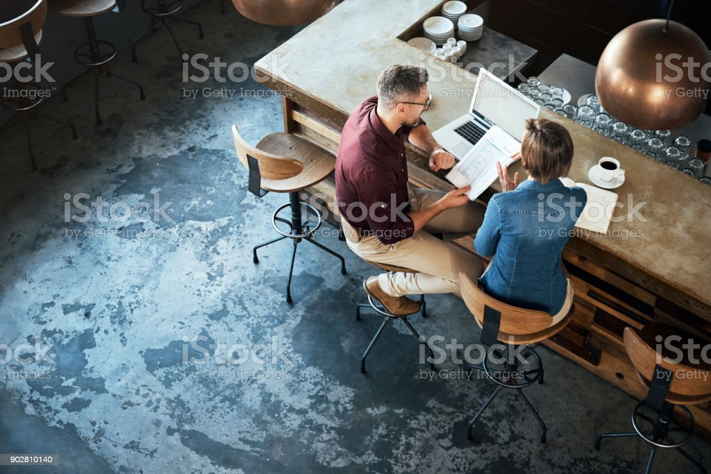 Getting work done at their local coffee shop stock photo