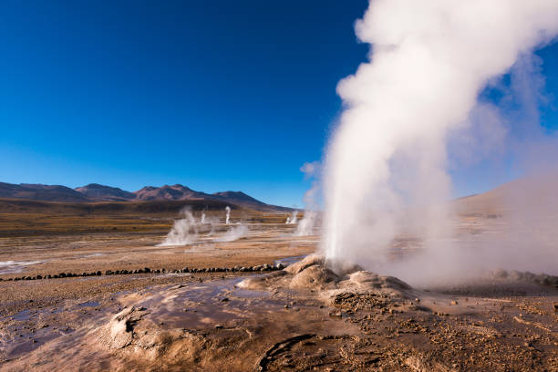 Geyser erupting activity in the Geysers del Tatio field in the Atacama Desert stock photo