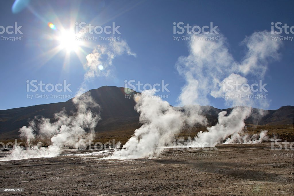 Geyser field El Tatio in back lighting, Atacama region, Chile stock photo