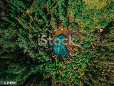 Beautiful Geyser lake with thermal springs that periodically throw blue clay and silt from the ground. Aerial dron view, Altai mountains, Russia