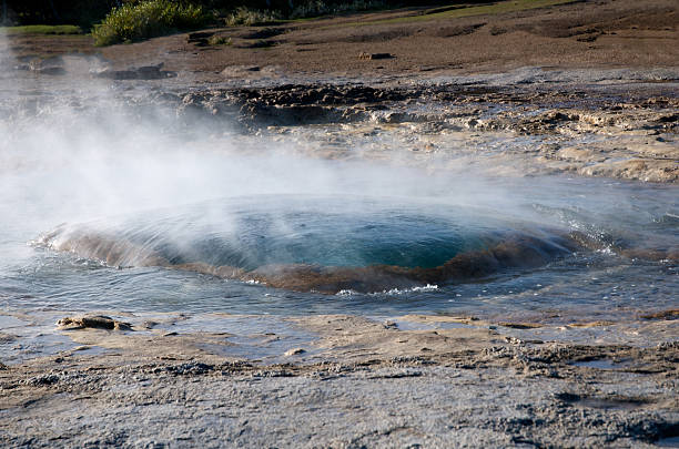 Geysir Alias Strokkur is Ready to Blow Water in Iceland Geysir alias Strokkur is ready to blow in Iceland. There is a lot of steam and the water is very hot. alias stock pictures, royalty-free photos & images