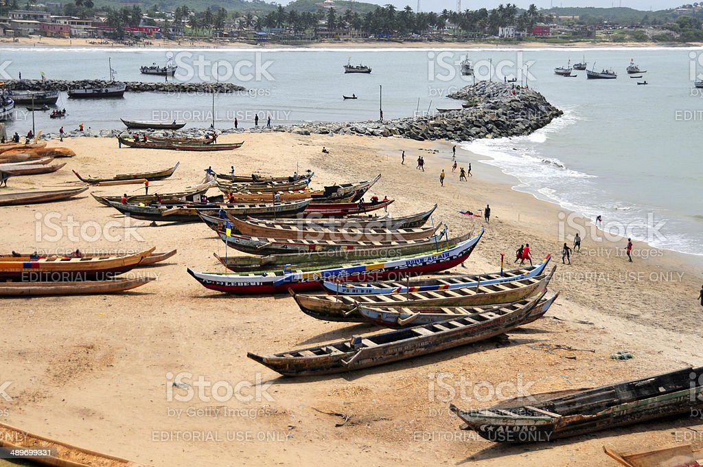 Ghana, Elmina - fishing boats and soccer stock photo