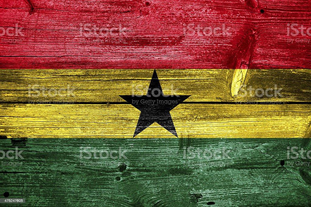 Ghana Flag painted on old wood plank texture stock photo