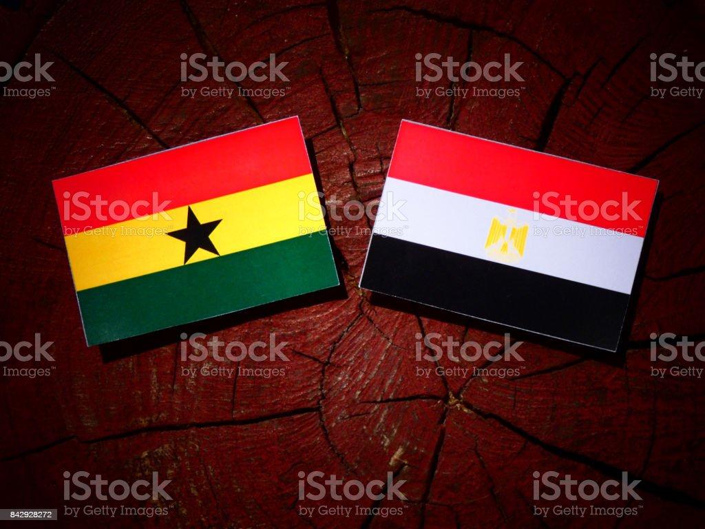 Ghanaian flag with Egyptian flag on a tree stump isolated stock photo