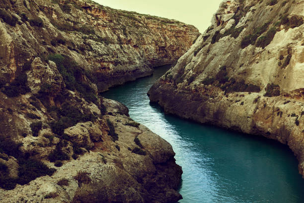 ghasri canyon, beauty of turquoise river on gozo malta - narrow stock photos and pictures