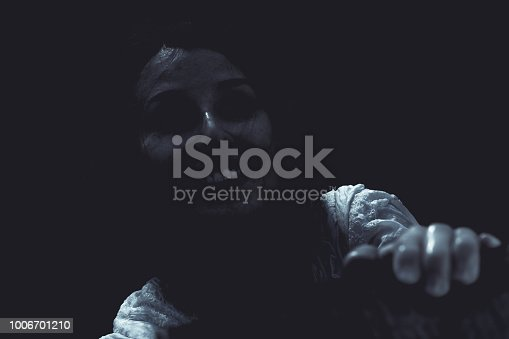 Gloomy and macabre portrait of a young woman who appears to be a ghost or revenant with an unsettling smile
