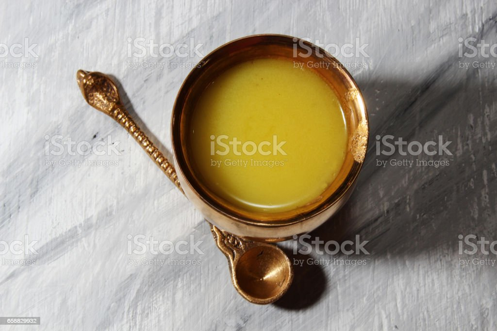 Ghee or clarified butter stock photo