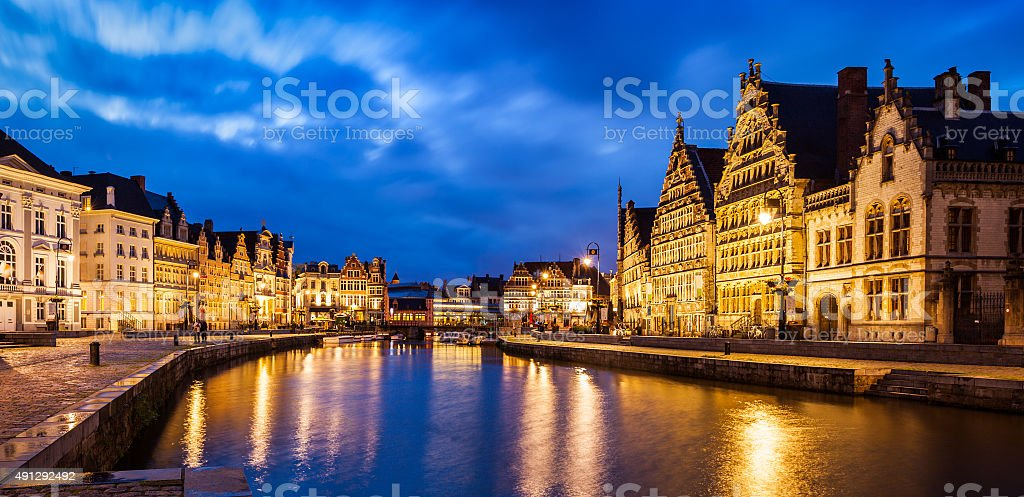 Ghent canal, Graslei and Korenlei streets in the evening. Ghent stock photo