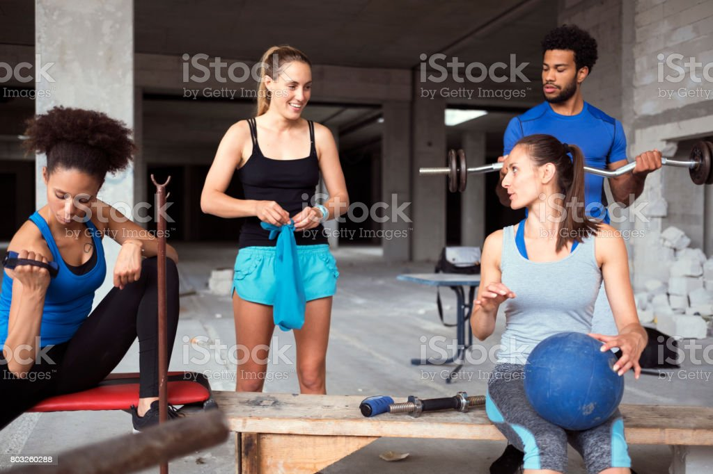 Ghetto gym and group of friends doing fitness stock photo