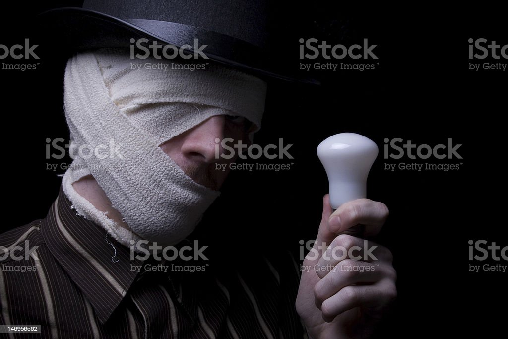 Ghetto Male A bandaged male holding a light bulb with an idea. Adult Stock Photo