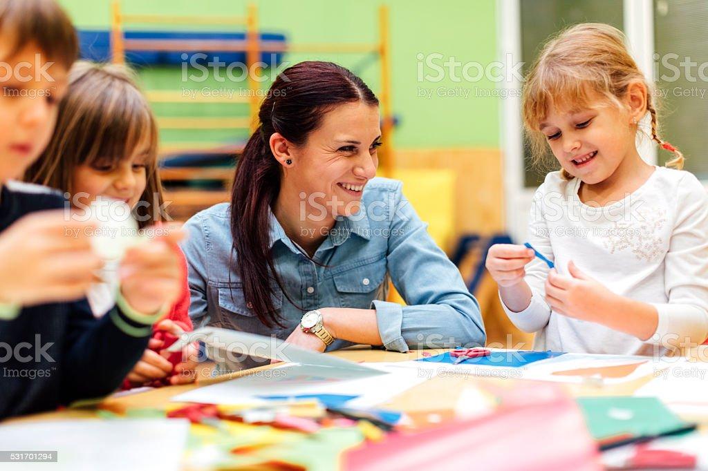 Ghildren Having Creative Activity in Kindergarten. stock photo
