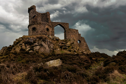 Mow Cop Castle is a folly at Mow Cop in the civil parish of Odd Rode, Cheshire, England. It is recorded in the National Heritage List for England as a designated Grade II listed building. The ridge, upon which the castle sits, forms the boundary between the counties of Cheshire and Staffordshire.