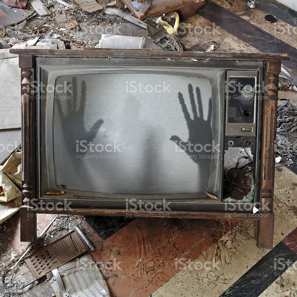 ghost appears on flickering tv set stock photo